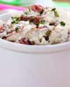 Potato salad doesn't have to be smothered in fattening mayonnaise to taste good. Apple cider vinegar and sweet onion give this potato salad flavor without adding fat or extra calories. Serve it warm.