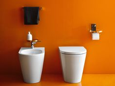 The Kartell Bidet Faucet is beautiful and high functioning. The flat top paired with slim handle adds a lot of character to any bidet set up. Laufen Bathroom, Bathroom Sets, Bathroom Fixtures, Modern Bathroom, Deco Orange, Orange Bathrooms, Toilette Design, Keramik Design, Bidet
