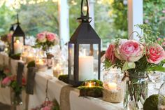 Lanterns and ball jars with flowers