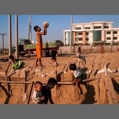 photo by @chien_chi_chang/@magnumphotos Children turn a factory construction site into a playground in the Hlaing Thaya industrial zone outside Yangon Myanmar (Burma.) #Myanmar #Burma #cccontheroad #cccJetLag #magnumphotos To watch the video Burma Land of Shadows copy and paste the link http://ift.tt/1NSXMND to another browser. by natgeo