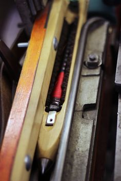 Close up of a wooden shuttle in the loom.#whitchurchsilkmill