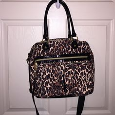 BETSEY JOHNSON BAG Excellent Condition handbag. Used once. Black patent satchel handles & details with gold zippers.  Removable cross body strap if you want to carry as a satchel.  3 front pockets. 2 main compartments w/ a cell phone pocket  and a misc. pocket in first compartment. In second compartment there's a side zipper pocket.  In picture 3 there is a small scratch but it's hardly noticeable. This bag is in great shape. Spring cleaning my loss your gain! No HOLDS, NO TRADES! All sales…