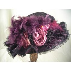 Black Hat with Plum. This hat is a new design with a lace top over a straw hat base. The crown is ruffled around the brim with a lace edge, black and plum flowers, plum sparkle bird and plum.