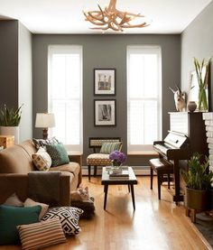 need to figure out a layout with piano and seating, like the neutrals here with color in pillows, simple
