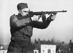 New weapons for the Home Guard. A soldier of the English Home Guard with a Tommy Gun on the Home Front in England during World War II in 1940 - pin by Paolo Marzioli