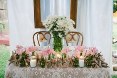 Monique and Wilbert's 75 guest wedding - Sweetheart Table... Photography by Stephanie Kapra  See this wedding on www.intimateweddings.com #sweethearttable #diy #weddingflowers