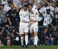 Gareth Bale (right) celebrates with Cristiano Ronaldo during Real Madrid's win over Manchester City