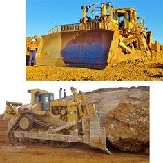 Caterpillar D11R pushing another massive rock