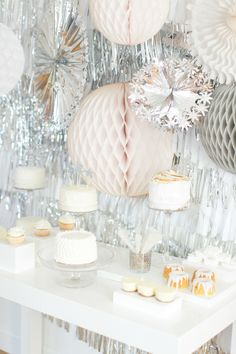 Loving West Elm's Party in a Box on #SMP Weddings and #SMPLiving today!! See more here: http://www.stylemepretty.com/living/2013/12/11/silver-white-fringe-backdrop | Ruth Eileen Photography