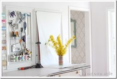 Roller shade mounted on wall/frame for quick photography