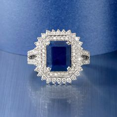Classic elegance. It's what connects us, generation after generation. It is what draws us in and captivates us all. It is the heritage and proud legacy of Ross-Simons. This deeply, beautifully blue 3.30 carat sapphire and .98 ct. t.w. diamond ring has an allure that endures. The central #sapphire is emerald-cut and framed in diamond rounds which also sparkle along the two-row band. 18kt white gold ring.  Click on the Sapphire and Diamond Ring for more details. #sapphirering #katemiddleton