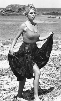 Brigitte Bardot walking by the shore.