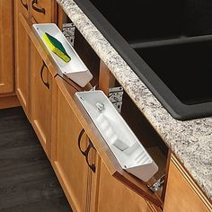 Store sponges and other kitchen or bath essentials out of site with Rev-A-Shelf's Tip-Out Trays. The kit includes 1 open tray, 1 accessory tray with a ring holder and soap dish and the hinges to install them.