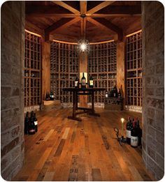 hardwood floors made from wine barrels. some planks feature product stamps, others have color variants due to the wine.