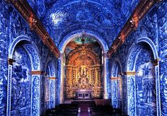 The magnificent interior of the church of São Lourenço is covered in vibrant blue and white azulejo tiles that Portugal is renowned for.