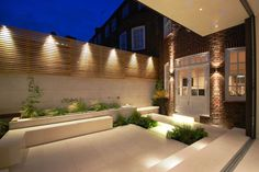 Charlotte Rowe used LED lighting and Swarovski crystals in the courtyard of a Chelsea house Garden Design Glow in the dark: night garden illumination Fence Lighting, Backyard Lighting, Exterior Lighting, Outdoor Lighting, Landscape Lighting, Lighting Design, House Lighting, Modern Lighting, Wall Lighting
