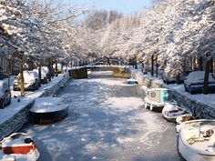 A frozen canal in Enkhuizen, The Netherlands Company Town, Winter Photos, Where The Heart Is, Netherlands, Places Ive Been, Holland, Dutch, Beautiful Places, Country