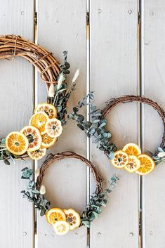 Create a simple orange and eucalyptus wreath for your front door with affordable dried flowers and preserved oranges from Afloral.com.