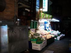 """A small, quiet fruit and vegetable stand, just steps off the frenetic, neon-bathed sidewalks of the main drag in Shibuya. Little pockets like this still exist here and there, reminding travelers that not everyone here is a gawking tourist in """"The Big Smoke""""..."""