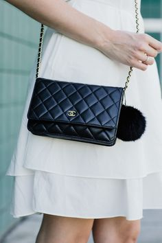 This black Chanel purse is the perfect accessory for any outfit.