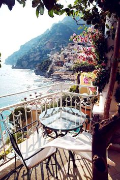 picture perfect. terraces dressed up with colourful buildings and sea views along the amalfi coast...