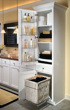 Extra tower by shower for pullout laundry and linen storage