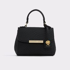 Inloving Sophisticated and playful, this satchel is suitable for business or pleasure.  Decorative luggage tag and magnetic closure add to the charm.