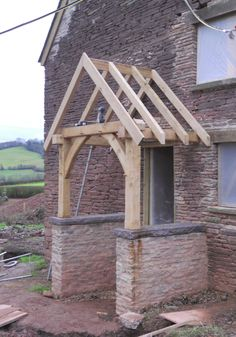 Aha, so this is how you build it! Low side walls (but in brick for us) might be an idea but I think Id prefer it open. Porch Windows, Front Door Porch, Front Door Entrance, Porch Roof, Front Entrances, House Front, Porch Canopy, Door Canopy, Bungalows