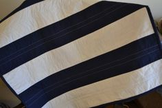 Customizable Rugby Stripe Crib Size Quilt by CreativeSeams on Etsy, $70.00. Found the quilt that I wanted it!! And got it, love that it is personalized to how I wanted! Perfect for my navy blue and orange nursery for my little boy!