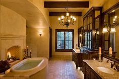 love the fireplace in this bath