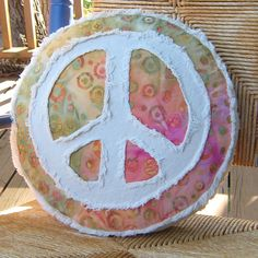 Peace sign pillow sherbet tie dye batik and distressed denim round pillow