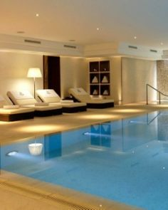 The indoor pool is surrounded by a dimly lit and romantic ambience. Spa Design, House Design, Spa Hotel, Interior House Colors, Luxury Pools, Luxury Homes Dream Houses, Indoor Swimming Pools, Home Spa, Luxury Houses