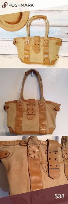 """J. CREW Neutral Canvas & Leather Purse J. Crew neutral tan and brown canvas and leather purse. Great basic everyday bag. Does have some staining, wear on the bottom, and hardware tarnishing. I've tried to capture this in photos. Still has a lot of life left. Buckle closure. Lots of pockets. Measures 18"""" wide across the top and 9"""" tall. No modeling. Smoke free home. I do discount bundles. J. Crew Bags Shoulder Bags"""