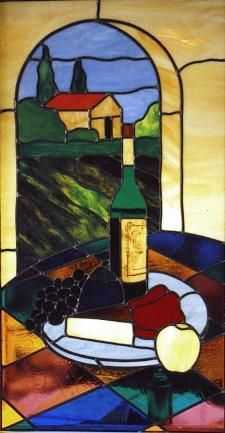 This Tuscan scene is featured in the window of a demonstration kitchen in a high end appliance store,