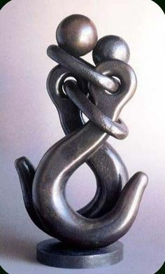 Two industrial crane hooks put together for a loving sculpture