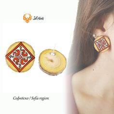 """Folk earrings with Bulgarian embroidery motives. The symbol is swastika which represents  the sun worship. Silver plated Stud earrings.  Обеци """"Шевица""""  / Shevitsa Софийска област / Sofia region"""