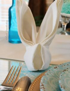 Easter Bunny Folded napkin for an Easter Table Setting decorations table Simple Easter Table Decor - Intelligent Domestications Bunny Napkin Fold, Easy Napkin Folding, Folding Napkins, Easter Table Decorations, Easter Table Settings, Easter Dinner, Easter Party, Brunch Places, Diys