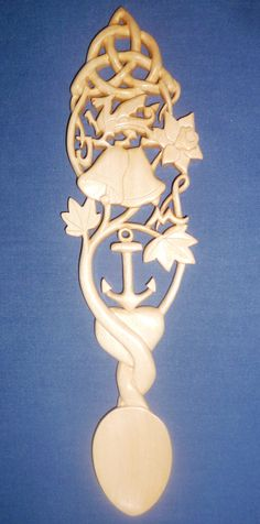 This love spoon shows a love of the sea combined with a Welsh dragon and knot.  www.adamking.co.uk
