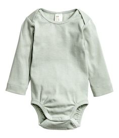 Light green. BABY EXCLUSIVE/CONSCIOUS. Long-sleeved bodysuits in soft, ribbed…