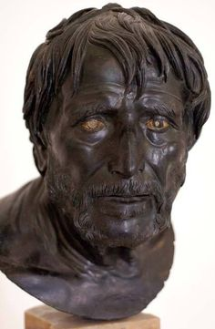"""""""Seneca"""", bronze with inlaid eyes, Roman, 1st century CE. Found in the Villa of the Papyri in Herculaneum. While commonly called Seneca that is only one possibility and academics usually refer to it more correctly as the head of a man, possibly a poet or philosopher."""