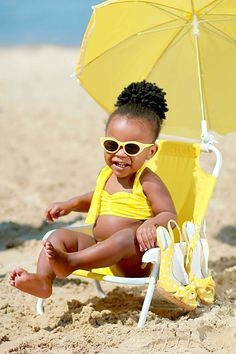 beach baby...find a sandy location at your favorite beach...coordinate colors of bathing suit, sunglasses, child size beach chair and umbrella...zoom in close but make sure water is visible...adult shoes not necessary for this cute beach photo