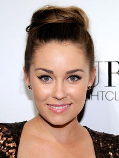 Always the fashionista, Lauren Conrad, sweeps up her hair for a super-chic, Audrey Hepburn-inspired updo.