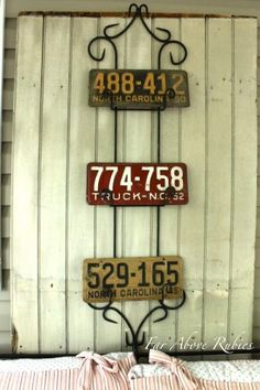 Old license plates in a plate rack! Love this idea!