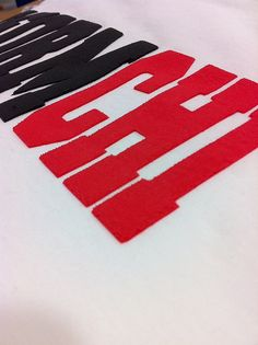 Close up of a high density ink print.  The image was printed using special high density ink and screens that print with some vertical height, instead of just laying flat on the shirt.  This has a distinctive feel similar to applique.  www.visualimp.com