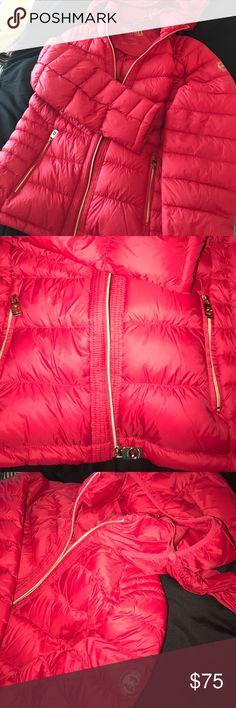 Michael Kors Puff Coat BRAND NEW, NEVER WORN without tags Michael Kors Puff Coat with hood. Red with gold zippers. Fill drawstring bag attached to store coat. Very cute. Light weight Michael Kors Jackets & Coats Puffers