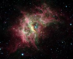Stars and planets appear to be under construction in dusty nebula RCW 49. This Spitzer Space Telescope false-color infrared view shows that known, hot stars are well on their way to clearing out the nebula's central regions.