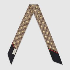 862ca4f440e9 Shop the GG bees silk neck bow by Gucci. The bee is an archival code