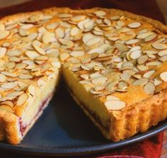 Italian Almond Tart 1 rolled-out round of tart dough 8 Tbs. stick) unsalted butter, at room temperature lb. almond paste, cut into cubes cup sugar 2 eggs cup unbleached all-purpose flour cup raspberry, plum or cherry jam cup sliced almonds Desserts Français, Delicious Desserts, Dessert Recipes, Italian Desserts, Italian Recipes, Plated Desserts, Dessert Ideas, Italian Cookies, Canadian Recipes