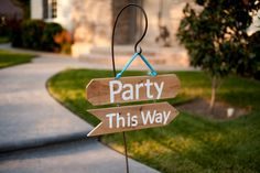 """party this way"" sign"