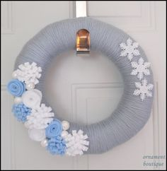 Snow yarn and felt wreath. I had an idea for a similar one, but I like their addition of little pearls.